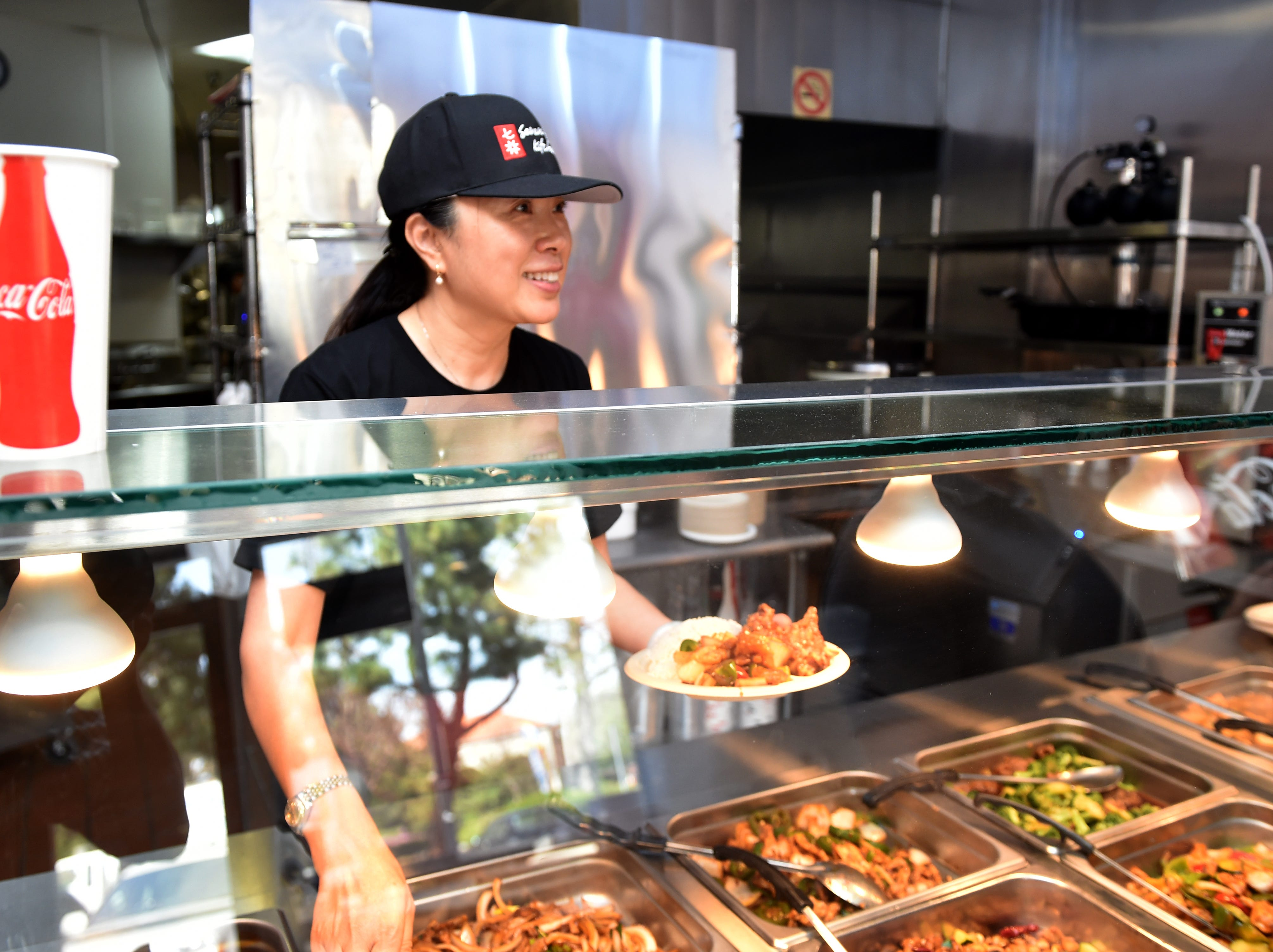 Jennifer Dong, who along with husband Paul owns of Seven Spice Kitchen in Newbury Park, prepares a lunch order on Monday.