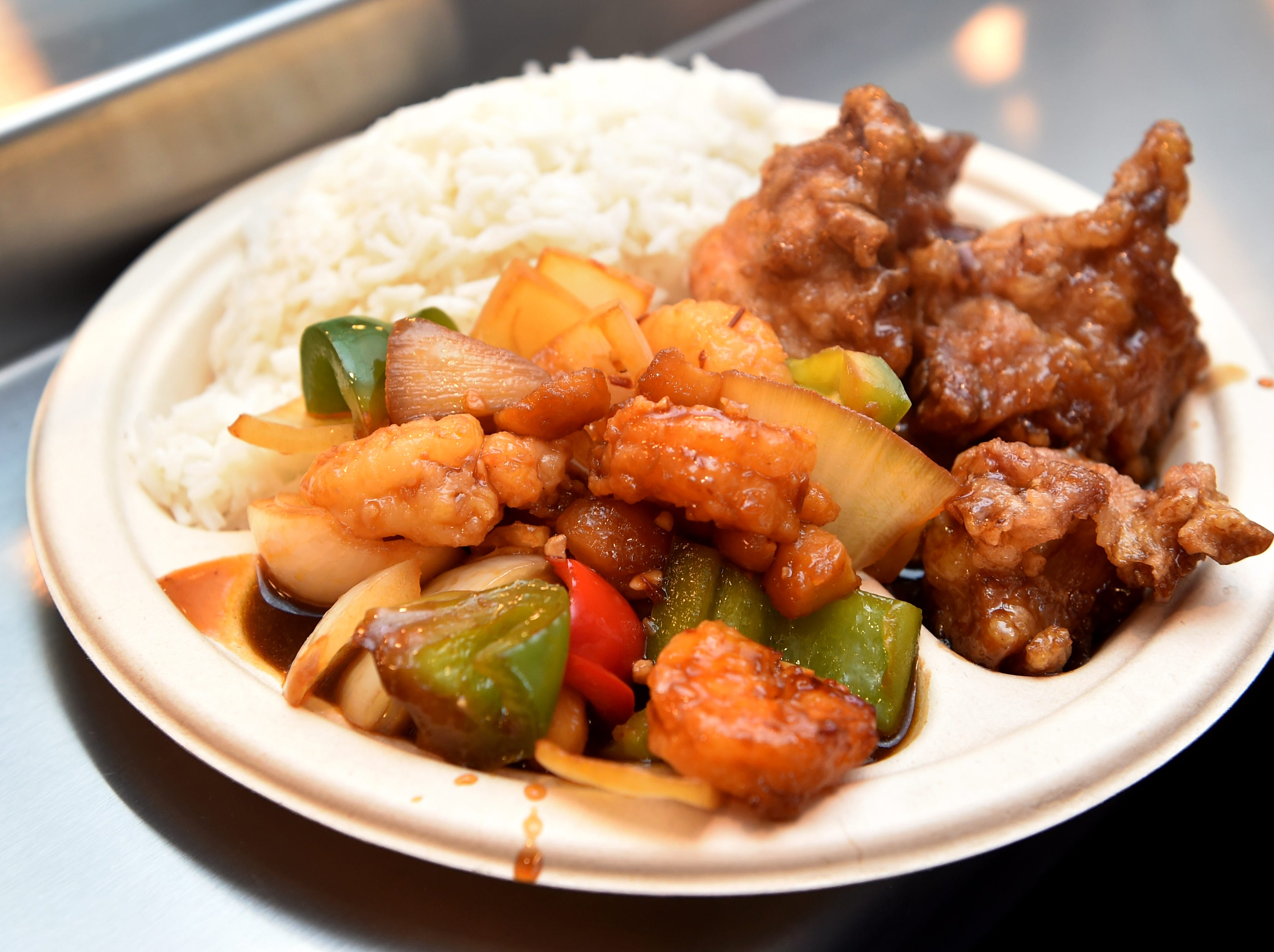Shrimp with Vegetables and Spicy Chicken Wings are among the menu items at Seven Spice Kitchen in Newbury Park.