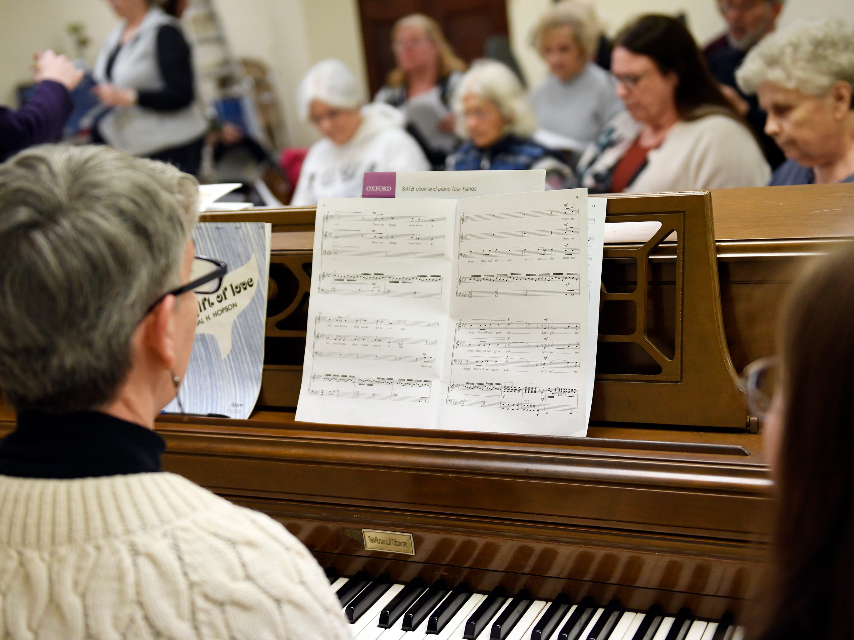 Gae Finch provides accompaniment on the piano during a rehearsal for the Singing Ambassadors at the Vineland Senior Center on Monday, April 1, 2019.