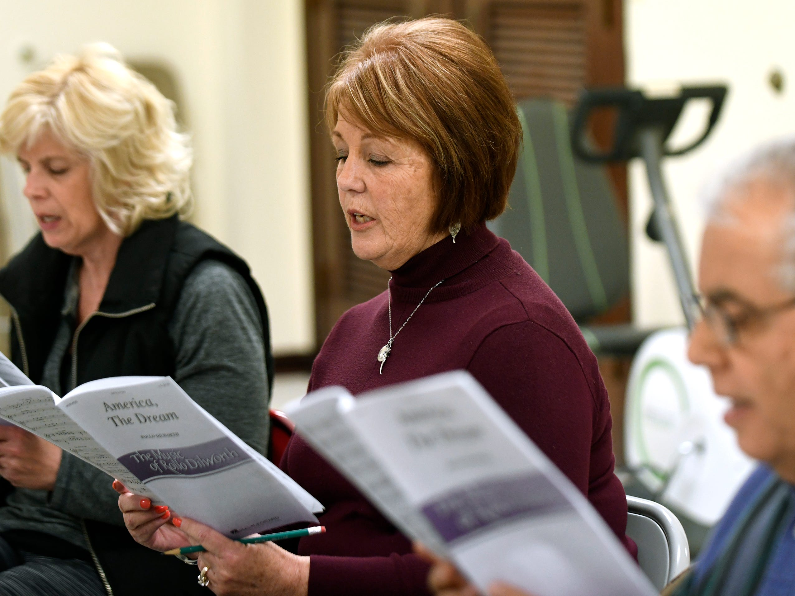 Donna Strain, president of the Singing Ambassadors, sings during rehearsal at the Vineland Senior Center on Monday. After 62 years of entertaining, the group is preparing for their final concert.