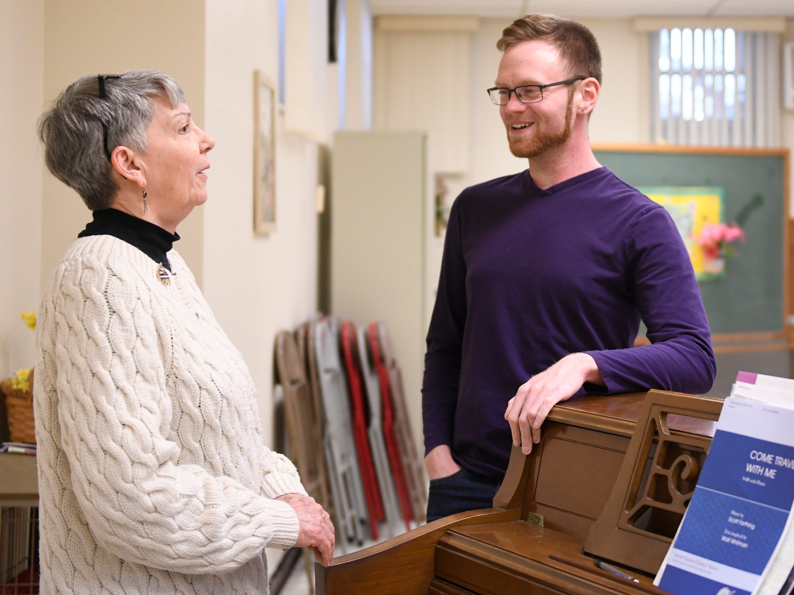 Gae Finch and Kyle Sheppard talk before Monday's Singing Ambassadors rehearsal at the Vineland Senior Center. After 62 years of entertaining, the group is preparing for their final concert.