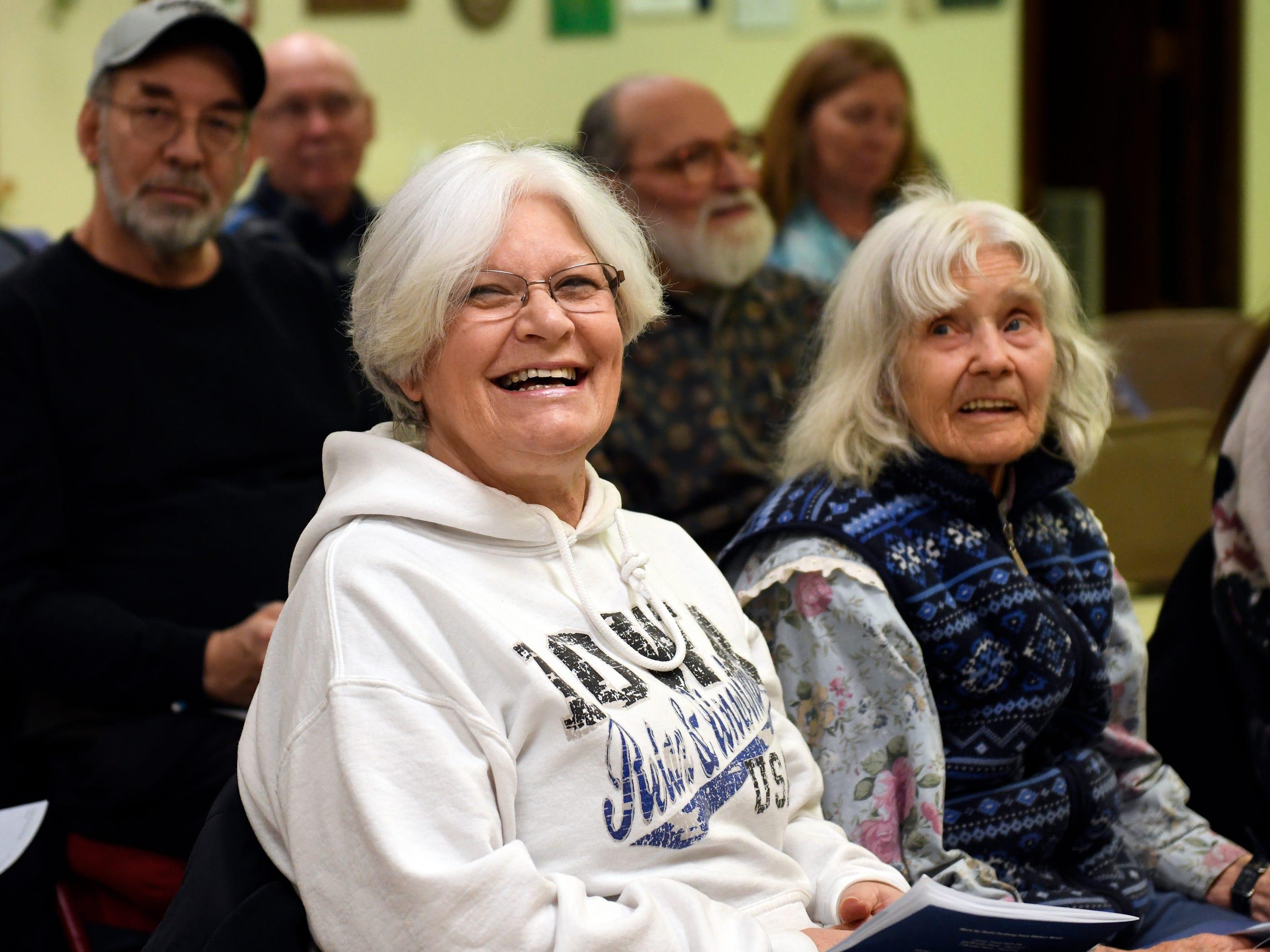 Darlene Ehrlich, a member of Vineland's Singing Ambassadors, gets ready for rehearsal at the Vineland Senior Center on Monday.