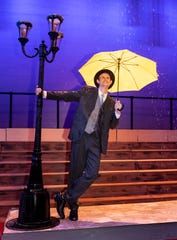 "Andrew Haagensen rehearses for Golden West's spring play ""Singin' in the Rain"" at LJ Williams Theater."