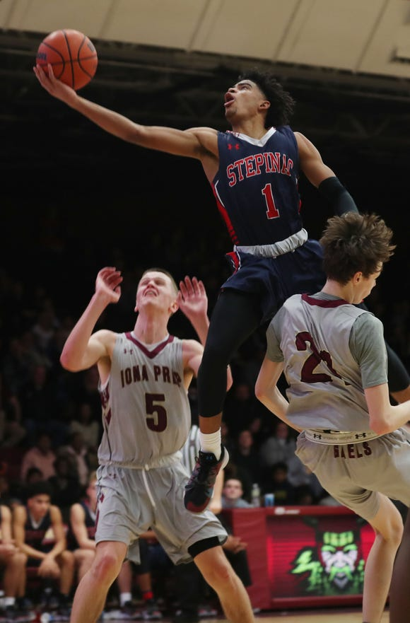 Stepinac's RJ Davis (1) drives to the basket in front of Iona's Aidan Hildebrand (5)  during basketball action at Iona College in New Rochelle Feb. 2, 2019. Stepinac won the game 65-59.