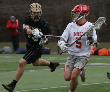 North Rockland's Joe Gianella (5) keeps the ball away from Nanuet's John Kiernan (13) during boys lacrosse game at Torne Valley Complex in Hillburn April 2, 2019. North Rockland defeats Nanuet 10-2.