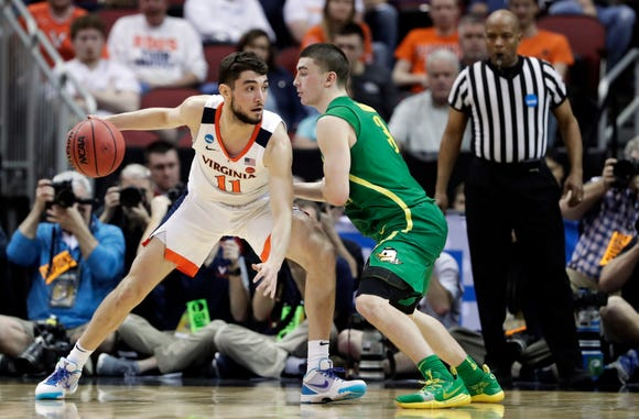 Virginia's Ty Jerome (11) is defended by Oregon's Payton Pritchard (3) during the second half of a men's NCAA Tournament college basketball South Regional semifinal game, Friday, March 29, 2019, in Louisville, Ky.