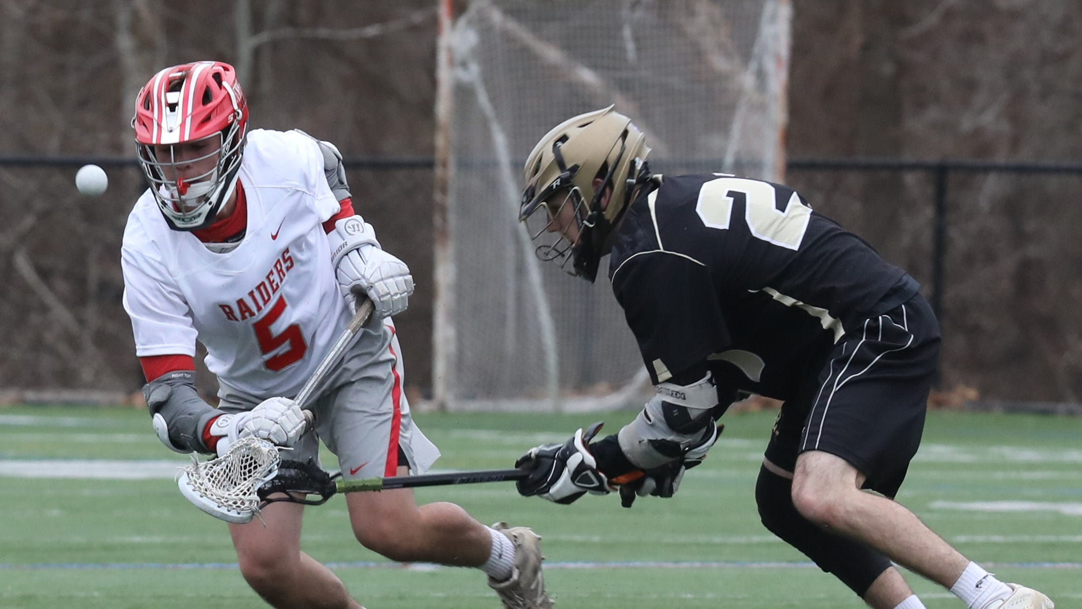 Nanuet's Matthew Lowther (21) guards North Rockland's Joe Gianella (5) battle for control of the ball during boys lacrosse game at Torne Valley Complex in Hillburn April 2, 2019. North Rockland defeats Nanuet 10-2.