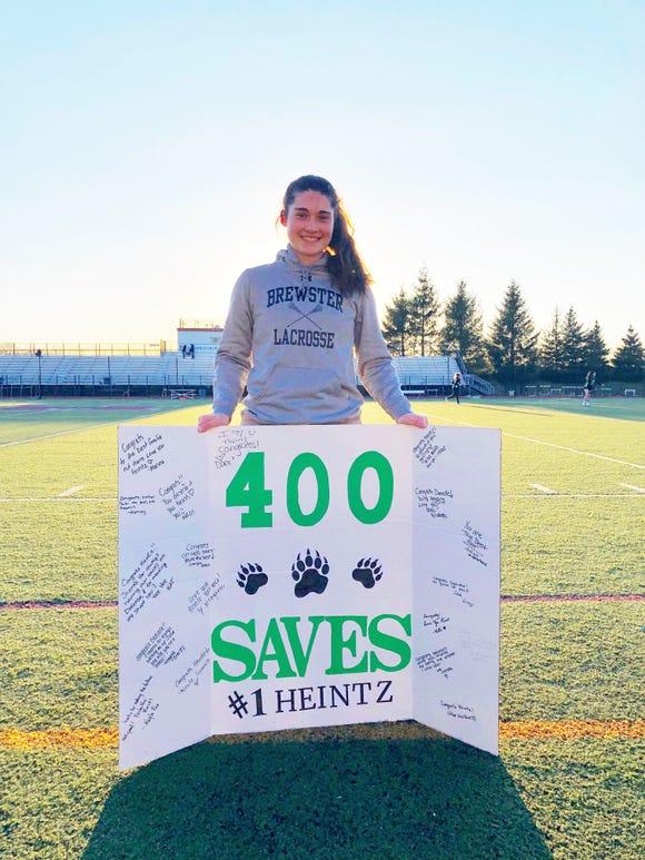 Brewster goalie Danielle Heintz celebrates 400th save.