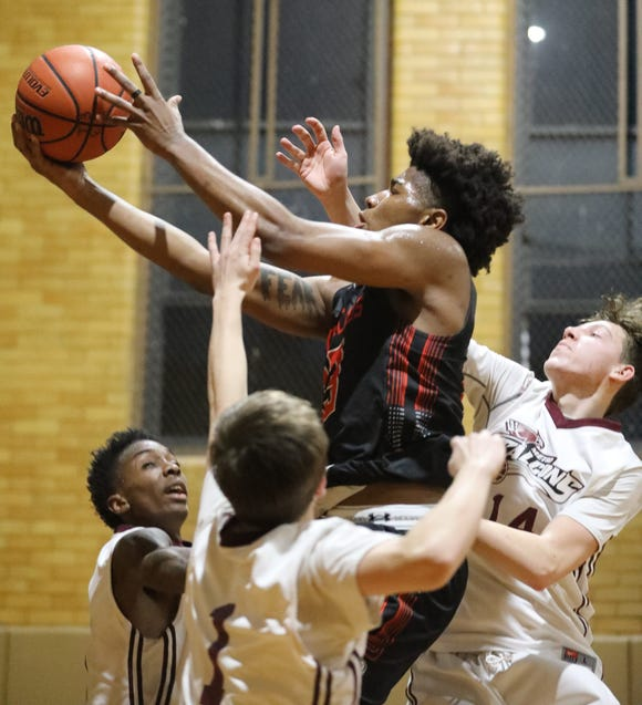 Nariq Chisholm (13) of New York Gauchos goes up for a layup over New York Falcons during the 73rd edition of the Sinis/Ciccone Memorial Tournament at Our Lady of Mercy in Port Chester April 1, 2019. New York Gauchos wins the title 116-101 over New York Falcons.