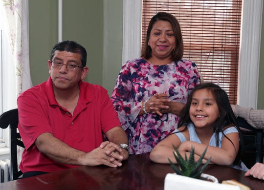 Alejandro, left, Maria Elena Carreño with daughter Alexa in their Sloatsburg home on Tuesday, April 2, 2019.  The Carreño's were renting the house when the owner let it go into foreclosure.