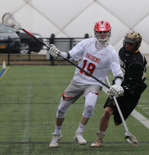 Nanuet's JP Alicata (22) guards North Rockland's Luke Morris during boys lacrosse game at Torne Valley Sports Complex in Hillburn April 2, 2019. North Rockland defeats Nanuet 10-2.