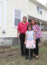 Alejandro and Maria Elena Carreño stand with their daughter, Alexa, in their Sloatsburg home on Tuesday, April 2, 2019.