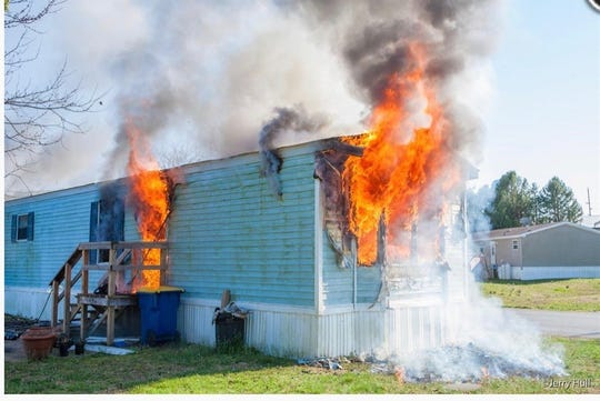 A trailer caught fire on Monday in Clayton, sending two inside to the hospital and injuring two firefighters.