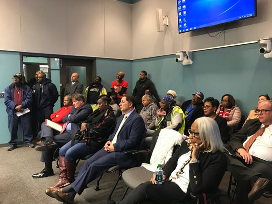 East Side residents and Vo-Tech district officials listen to a proposal for the district to lease a portion of a local park to install a turf practice field