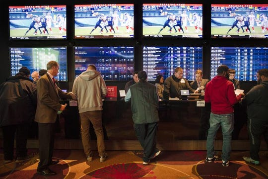 In this Dec. 13, 2018, file photo, gamblers place bets in the temporary sports betting area at the SugarHouse Casino in Philadelphia. Most of the states that moved quickly to legalize sports after a Supreme Court decision last year, including Pennsylvania, are still waiting for the expected payoff.