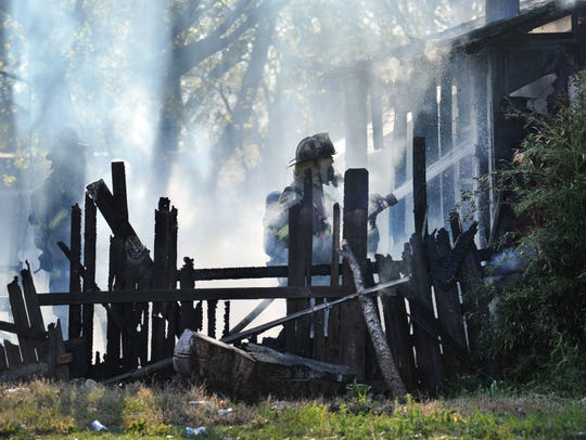 In this file photo, Wichita Falls Fire Department firefighters battle a blaze. Two show dogs were rescued from a house fire Monday afternoon.