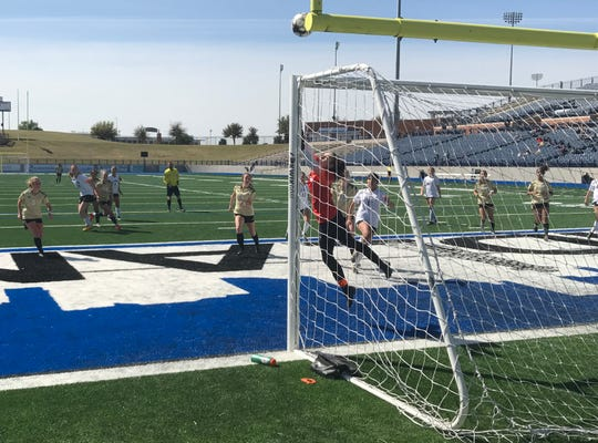 El Paso High goalkeeper Natasha Worm makes a save off Rider's corner kick Friday in the second half of the Lady Raiders' 2-1 win.