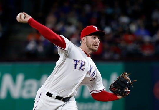 Texas Rangers relief pitcher Adrian Sampson throws to the Houston Astros in the fourth inning of a baseball game in Arlington, Texas, Monday, April 1, 2019. (AP Photo/Tony Gutierrez)