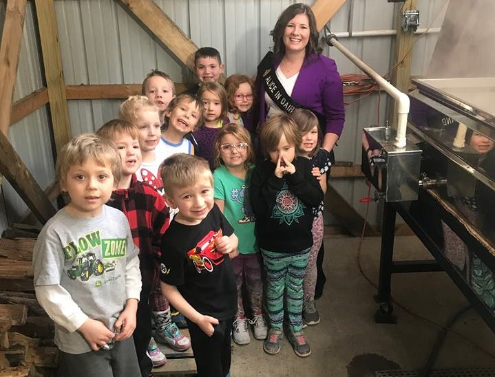 71st Alice in Dairyland Kaitlyn Riley learns about syrup production with Albany elementary students.