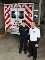 Chief Russell Taylor and Lt. Landon Duhamel with the South Zanesville Fire Department's ambulance. The department is now able to have paid emergency medical technicians on the staff.