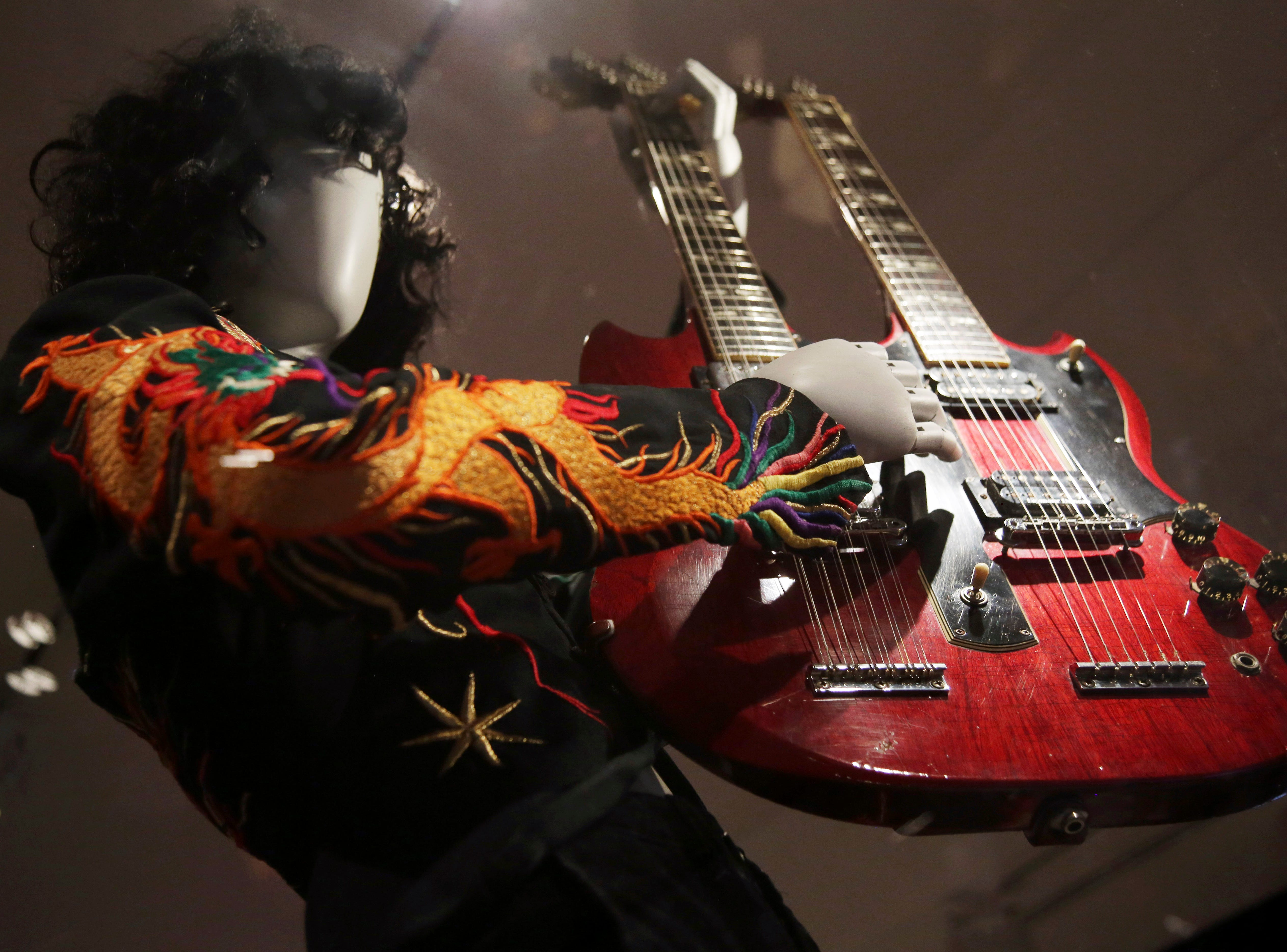"""A double-neck guitar played by Jimmy Page of Led Zeppelin is displayed at the exhibit """"Play It Loud: Instruments of Rock & Roll,""""."""