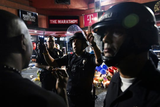 LAPD shut down the corner of Slauson and Crenshaw after multiple people were stabbed during a vigil for Nipsey Hussle on April 1, 2019 in Los Angeles.