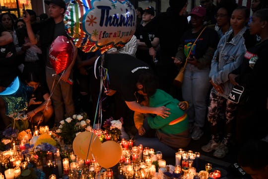 Mourners pay their respects to Nipsey Hussle near his clothing store on April 1, 2019 in Los Angeles.