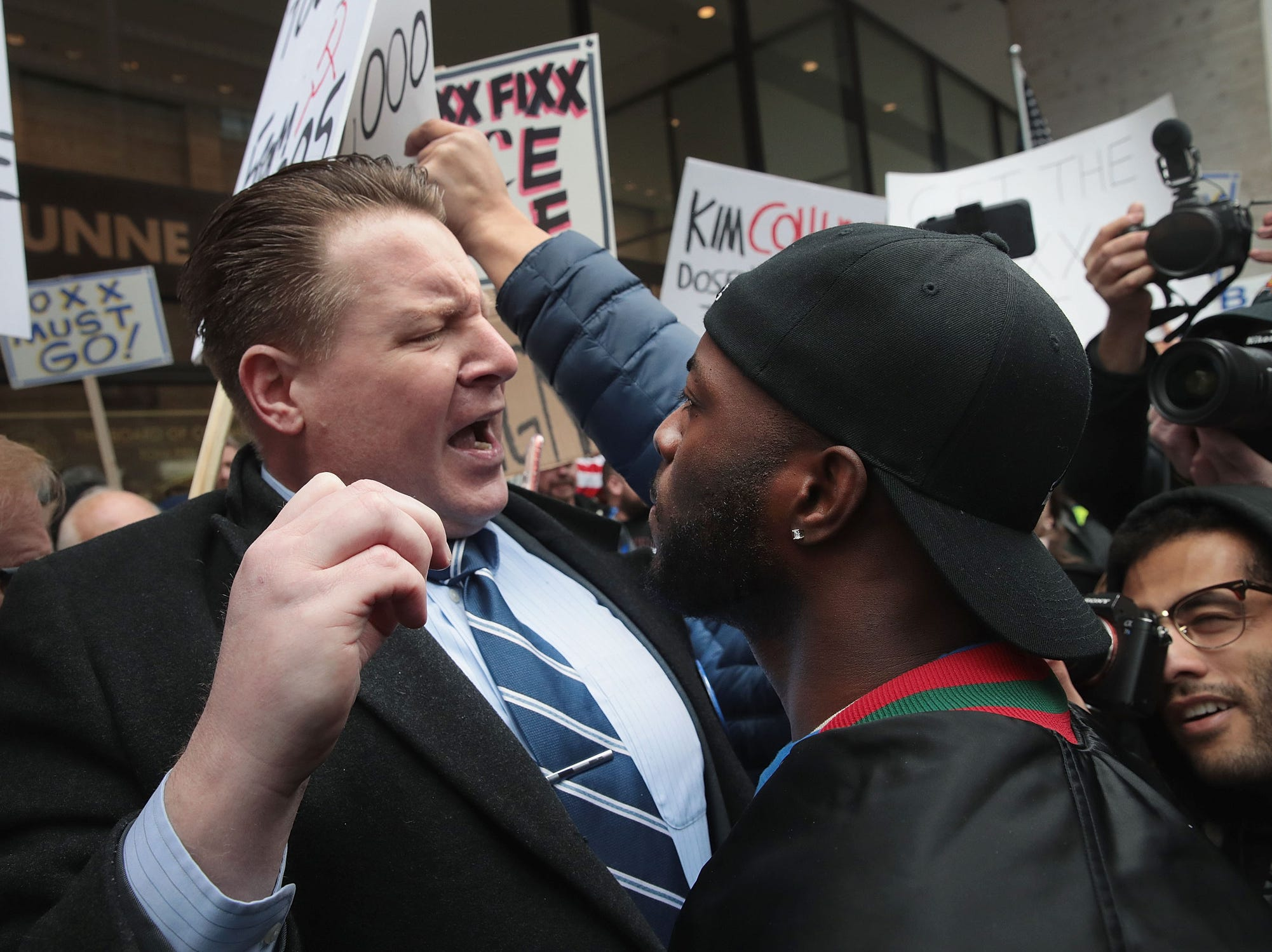 A supporter of Cook County State's Attorney Kim Foxx, right, argues with a protestor during a demonstration organized by the Fraternal Order of Police to call for Foxx's removal on April 1, 2019 in Chicago.