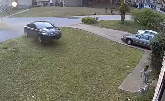 In this video frame grab made available by attorney Chris Stewart, shows a speeding car out of control before it hits LaDerihanna Holmes, 9, as she plays in her front yard Friday, March 29, 2019 in Lithonia, Ga.