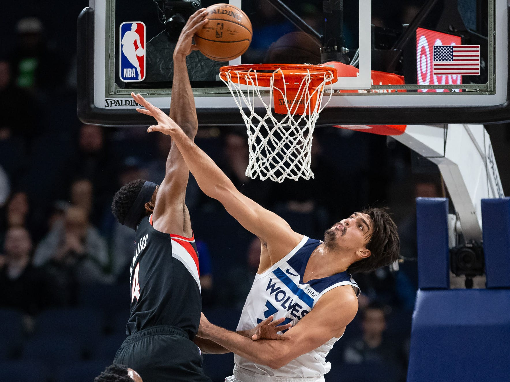 April 1: Trail Blazers forward Mo Harkless (4) puts Timberwolves defender Dario Saric (36) on a poster with the monster one-handed jam.