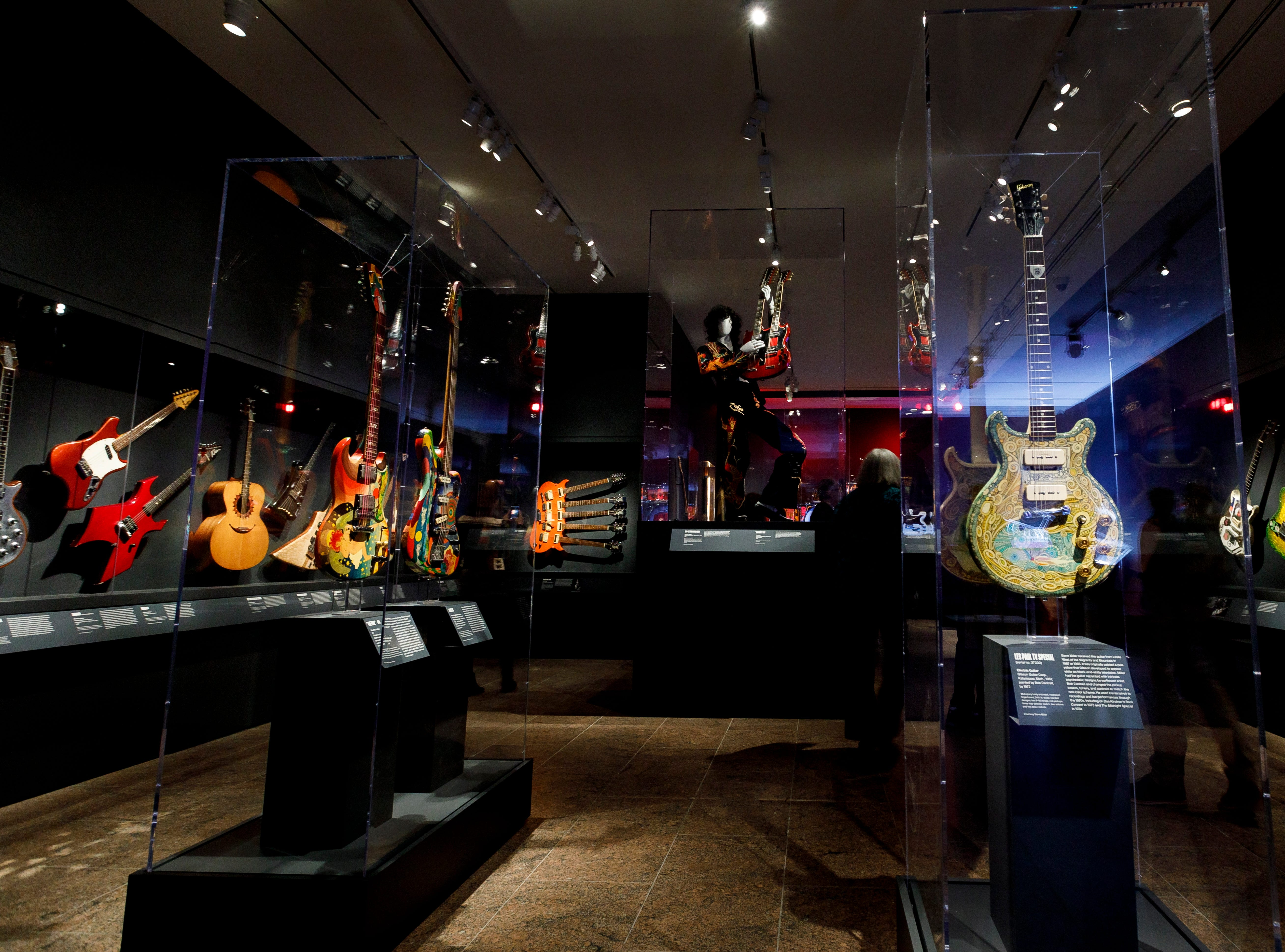 """A view of instruments on display during a preview of the new exhibit """"Play It Loud: Instruments of Rock & Roll"""" at the Metropolitan Museum of Art in New York."""