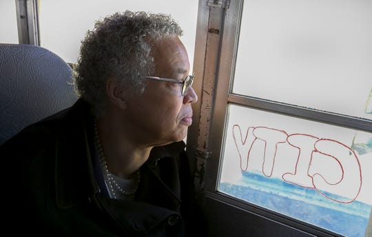 In this March 24, 2019 photo, Chicago mayoral candidate Toni Preckwinkle looks out over the Brighton Park neighborhood of Chicago, on a bus tour with members of the Brighton Park Neighborhood Council during a day of campaigning in Chicago.