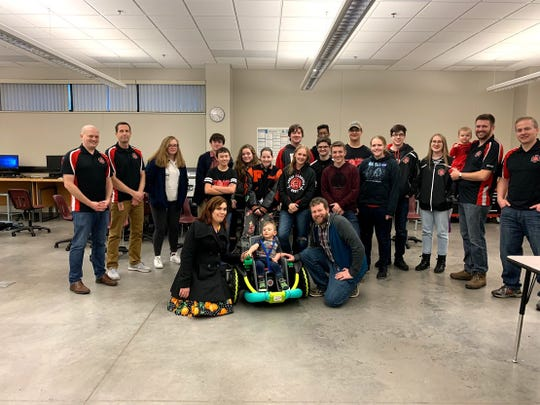 The members of Farmington High School's robotics team on the day they presented Cillian Jackson with the power wheelchair they built for him.