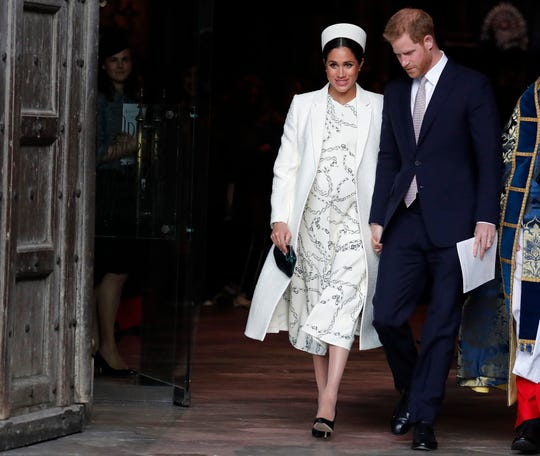 Duchess Meghan of Sussex and Prince Harry leave after attending the Commonwealth Service at Westminster Abbey on Commonwealth Day in London, March 11, 2019.