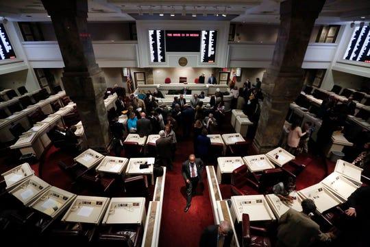 Alabama State Representatives walk through the Statehouse as the Alabama legislative session begins on Jan. 9, 2018, in Montgomery, Ala.