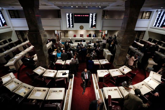 Alabama State Representatives walk through the Statehouse as the Alabama legislative session begins on Jan. 9, 2018, in Montgomery, Ala.