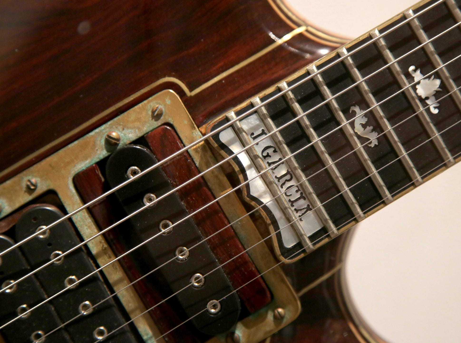 A custom guitar played by Jerry Garcia of The Grateful Dead on display.