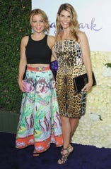 """Candace Cameron Bure (left) continues to show support for """"Fuller House"""" co-star Lori Loughlin (right)."""