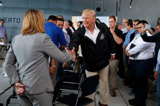 President Donald Trump shakes hands with San Juan Mayor Carmen Yulin Cruz during Trump's trip to Puerto Rico in 2017.
