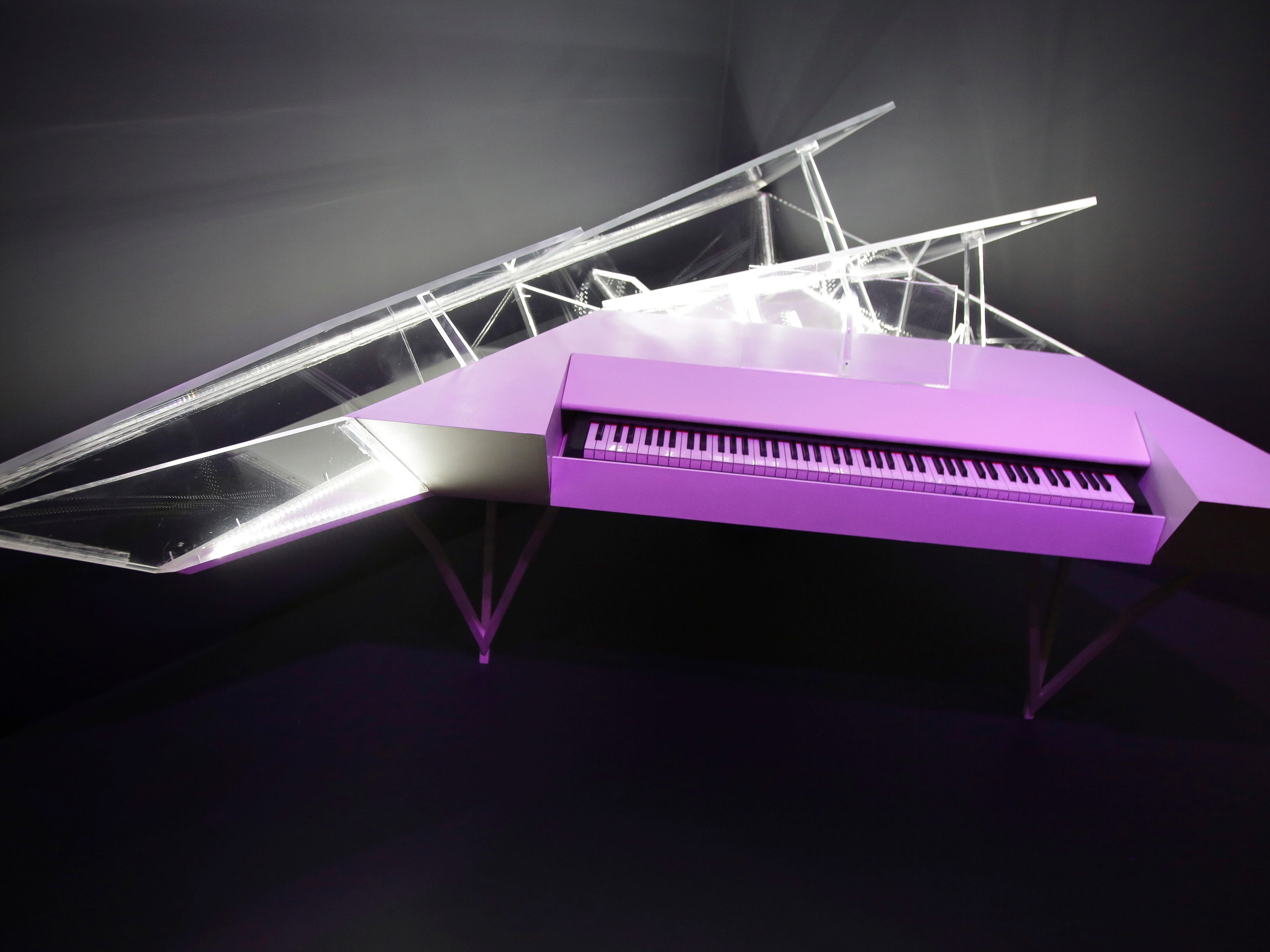 """An electric piano with a customized housing used by Lady Gaga is displayed at the exhibit """"Play It Loud: Instruments of Rock & Roll,"""" at the Metropolitan Museum of Art in New York, Monday, April 1, 2019. The exhibit, which showcases the instruments of rock and roll legends, opens to the public on April 8 and runs until Oct. 1, 2019."""