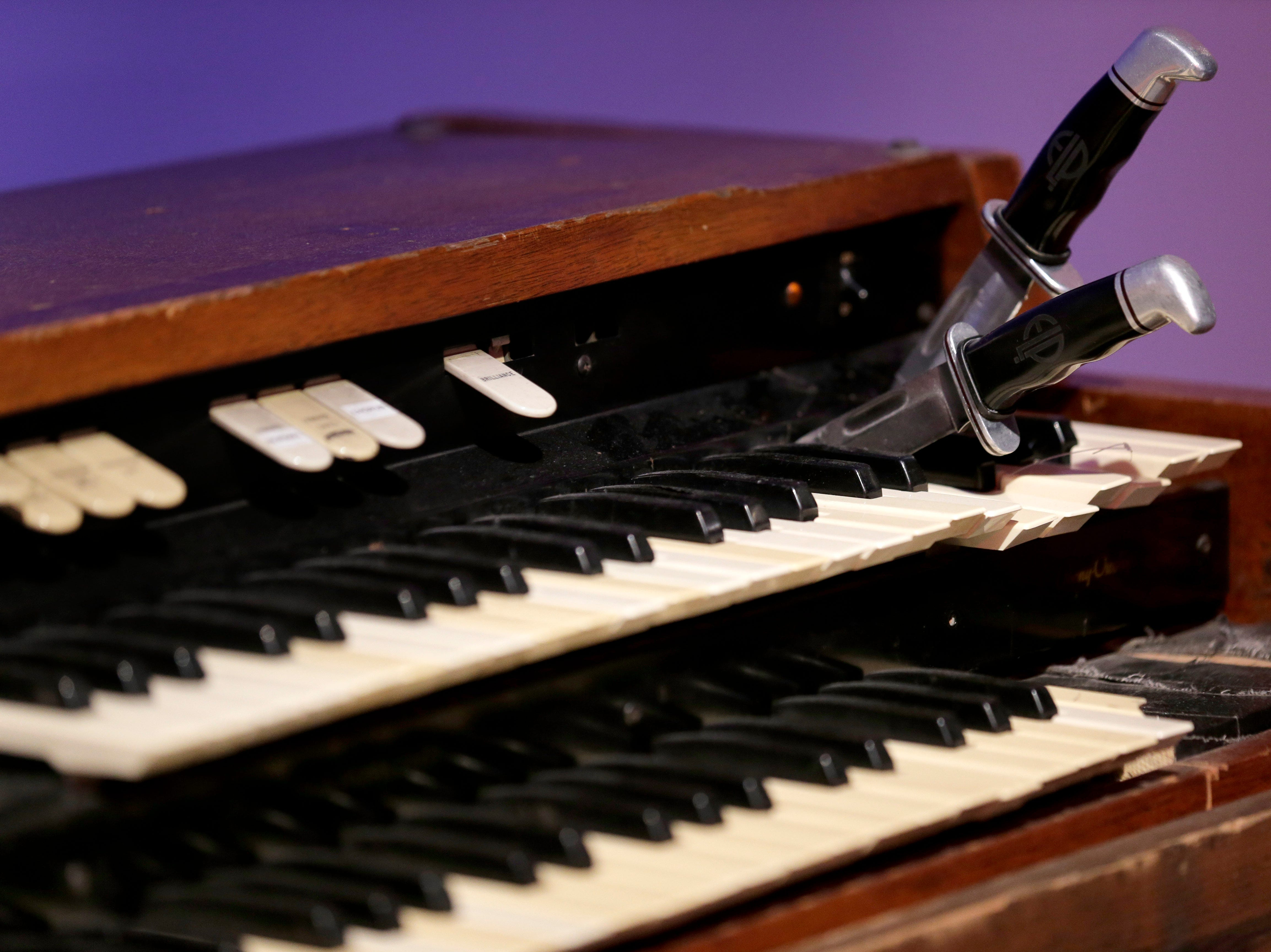 A stunt organ with knives that Keith Emerson used to hold notes on display.