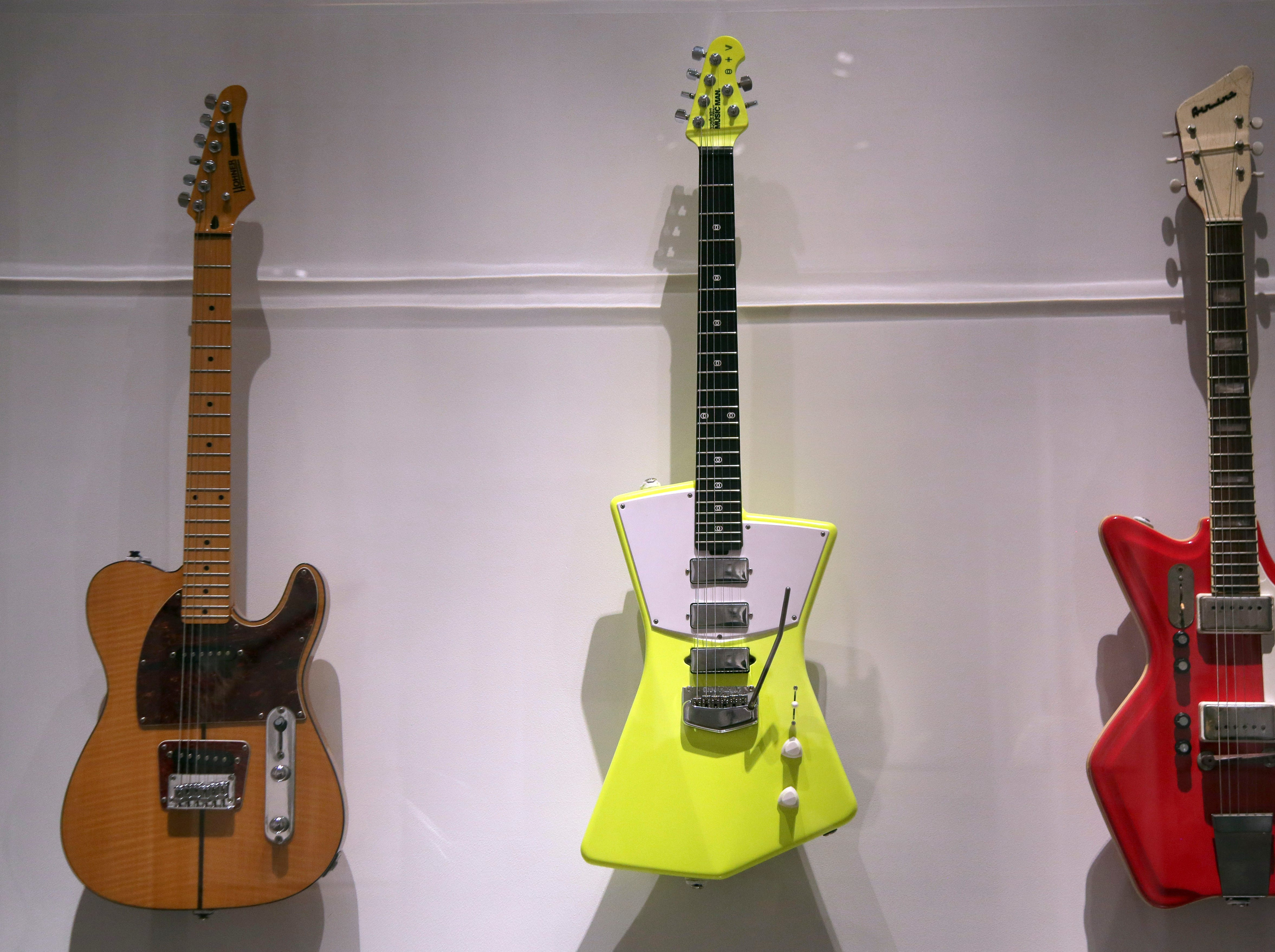 """Electric guitars are displayed at the exhibit """"Play It Loud: Instruments of Rock & Roll""""."""