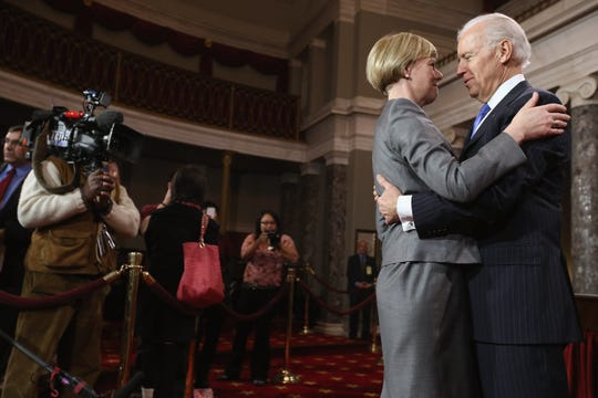 Sen. Tammy Baldwin, D-Wis., and then-Vice President Joe Biden in 2013.