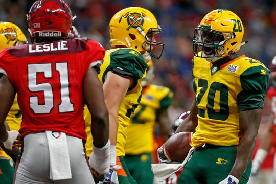 The Arizona Hotshots' Tim Cook (20) of reacts after scoring a touchdown against the San Antonio Commanders.