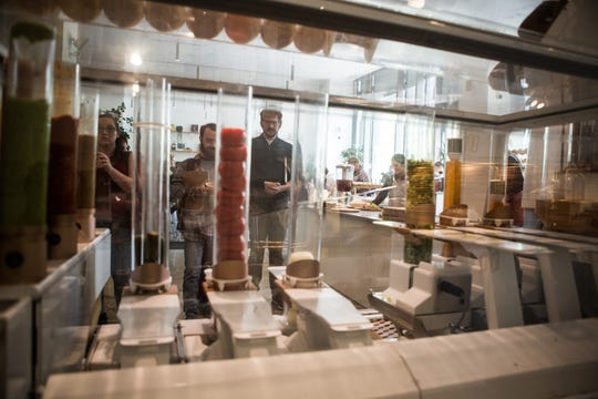 Customers stare at the burger-machine robot at Creator, a hot new San Francisco eatery where human employees do everything except make the food.