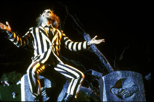 "Michael Keaton wore the striped suit in ""Beetlejuice."""