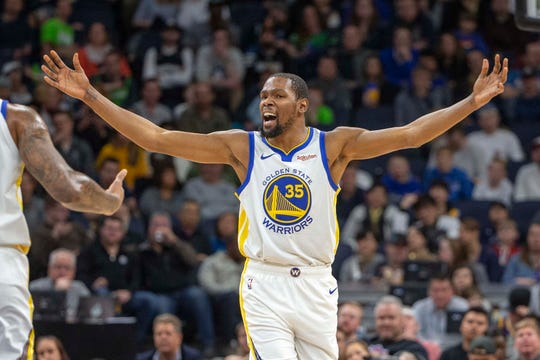 Warriors forward Kevin Durant reacts to a call in the first half against the Timberwolves at Target Center.
