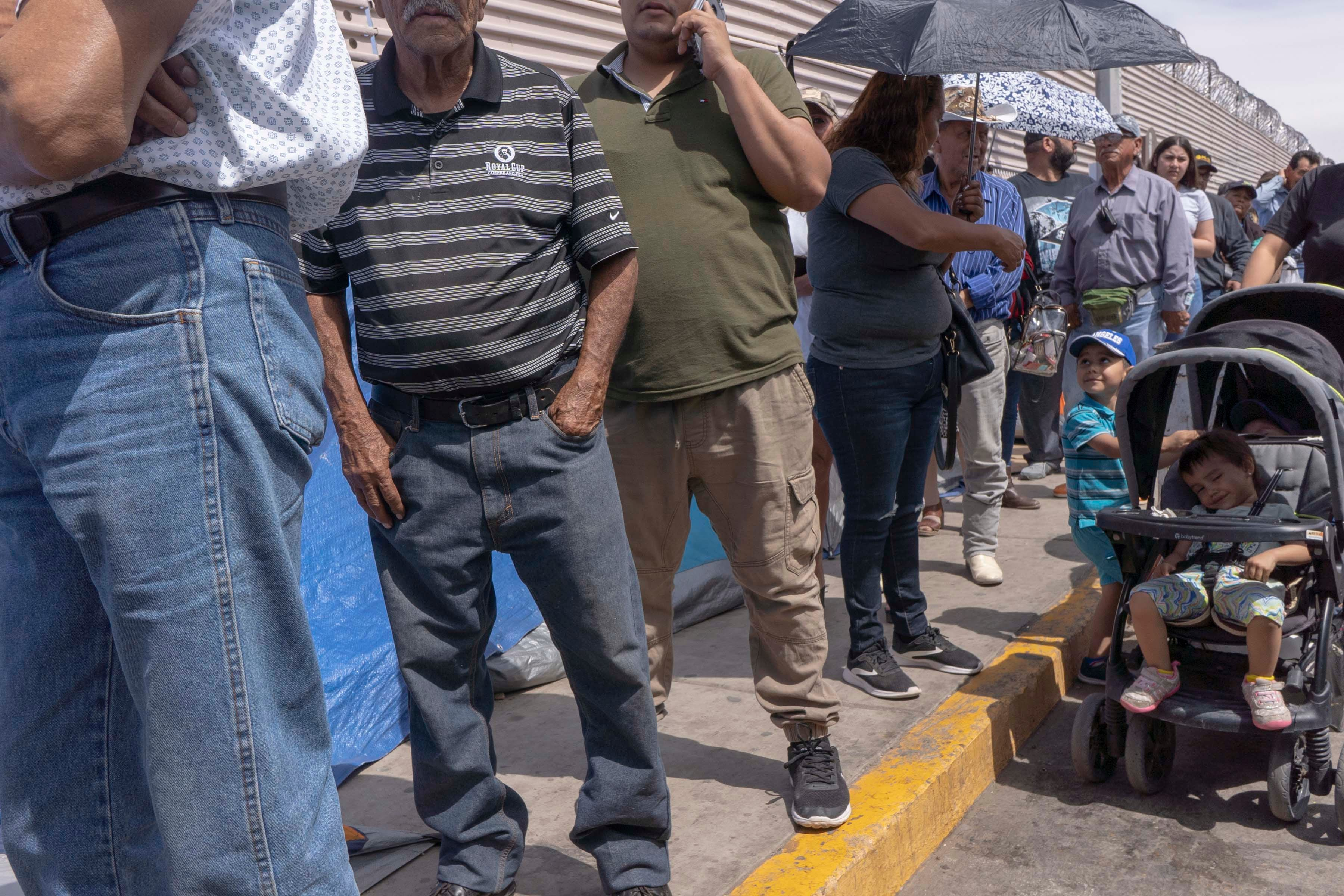 Asylum-seeking families with their children staying in tents housing waiting for their names to be called by Customs and Border Protection at the border in San Luis Rio Colorado, Mexico.