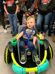 Cillian Jackson, 2, on the day the Farmington High School robotics team presented him with the power wheelchair students hand-built from a Power Wheels riding toy.