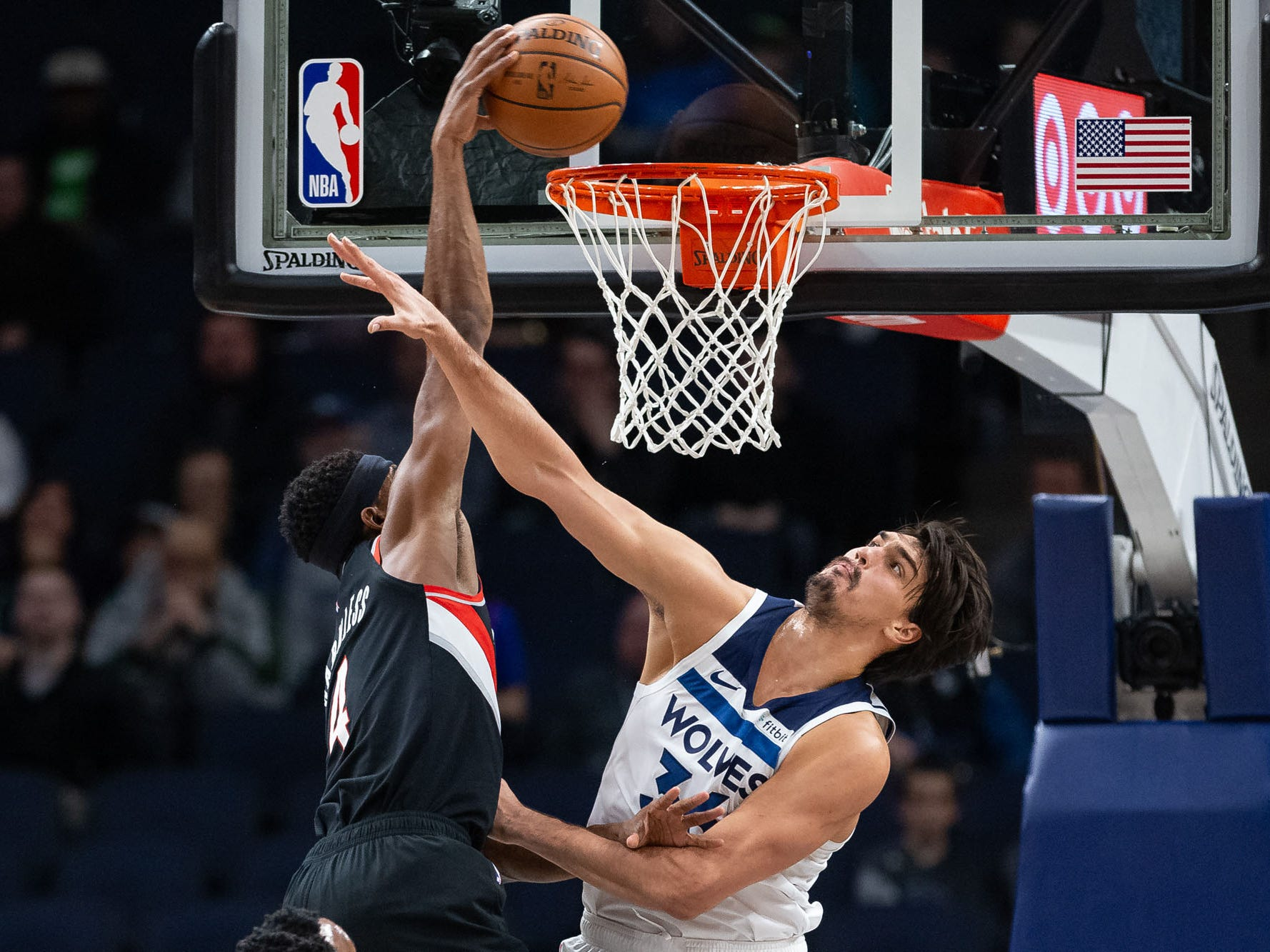 April 1: Trail Blazers forward Mo Harkless (4) puts Timberwolves defender Dario Saric (36) on a poster.